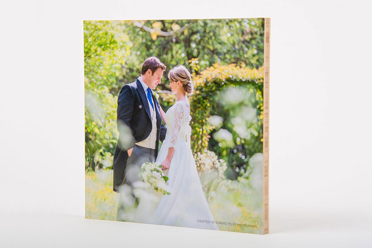 Custom photo wall art of a natural bamboo photo print of a couple on their wedding day