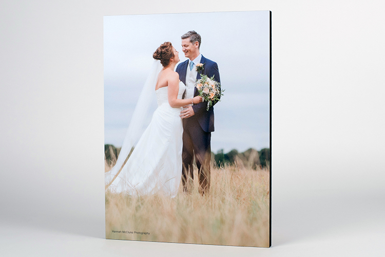 Custom photo wall art of a wooden photo block of a bride and groom outdoors